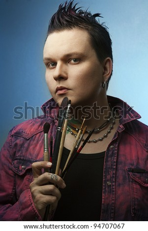 Artist with brushes. posing. - stock photo