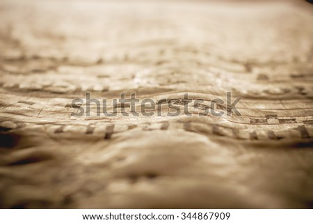 Artistic abstract background. A detail of an old medieval book parchment with gregorian chant sheet music notes artistic sepia vintage edit with a strong vignette and selective abstract focus - stock photo