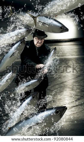 Artistic And Creative Photo Of A School Of Fish Splashing By A Senior Man Trying His Hand A Fishing For A Catch In A Plenty Of Fish In The Sea Conceptual - stock photo