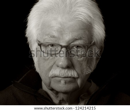 Artistic black and white portrait of a distinguished elderly man - stock photo