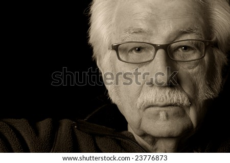 Artistic black and white portrait of an older man - stock photo