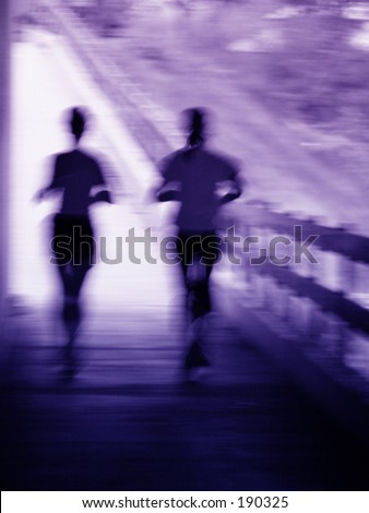 Artistic blue and purple blur of a running couple - stock photo