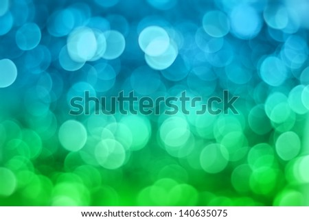 Artistic bokeh background. Soft defocused blue and green lights - stock photo