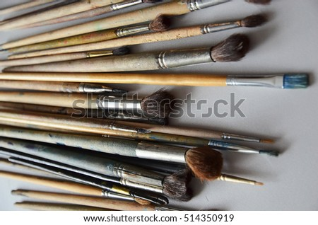 Artistic brushes on a gray background