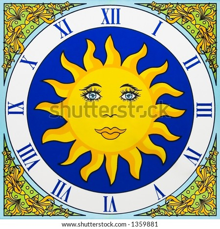 Artistic ceramic clock with a yellow sun and no pointers - stock photo
