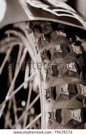 Artistic close-up of a racing bike tire tread Sepia toned - stock photo