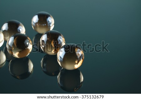 Artistic composition of marble clear glass ball