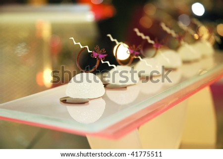 artistic dessert with white chocolate and sugar - stock photo