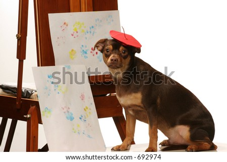 artistic dog with his paw print painting - stock photo