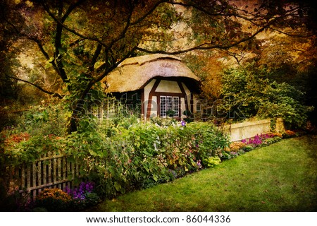 Artistic image of an enchanted English style cottage in the woods - stock photo