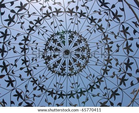Artistic iron lattice against the blue sky - stock photo