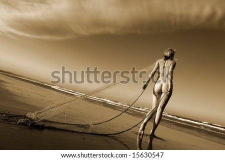 Artistic nude on beach with fishing net - stock photo