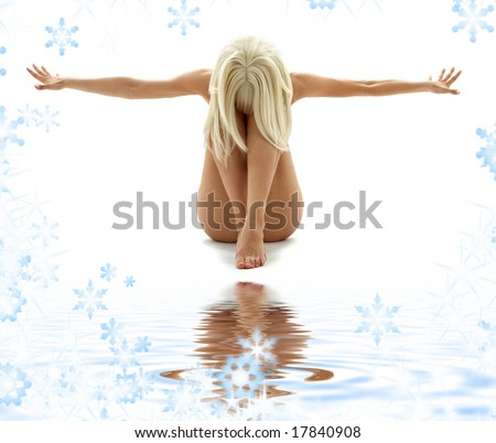 artistic nudity style picture of woman on white sand - stock photo