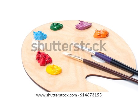 Artistic palette with colored oil paint