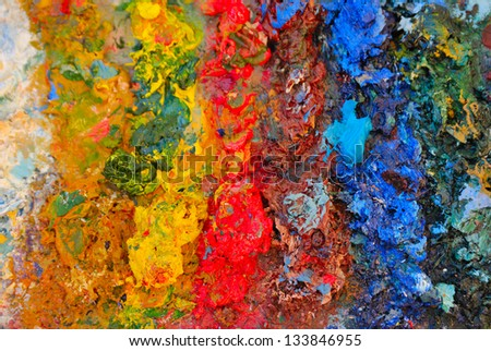 Artistic palette with oils paints.