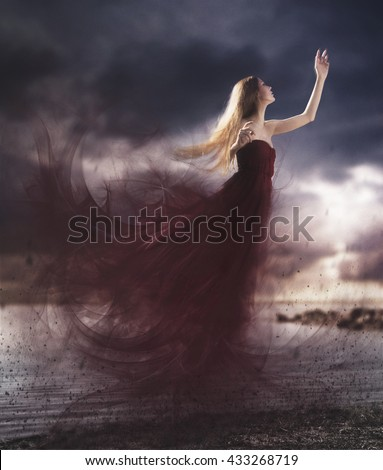 Artistic photography manipulation of a girl flying with a long red dress with a cloudy sky in the sunset. Blonde woman levitate. - stock photo