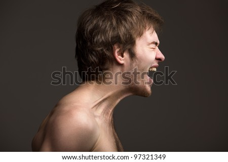 Artistic portrait of artistic men, demonstrating the strong emotions - stock photo