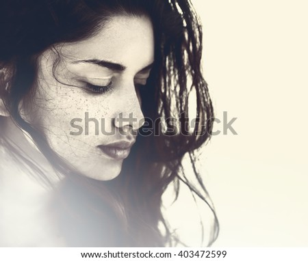 Artistic portrait of beautiful sensual young woman