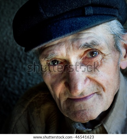 Artistic portrait of friendly senior old male - stock photo