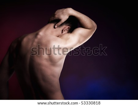 Artistic portrait of male from behind - stock photo