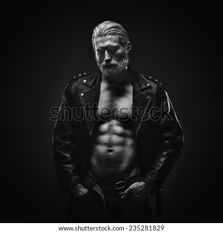 Artistic portrait of muscular mid aged handsome man with gray hair - stock photo