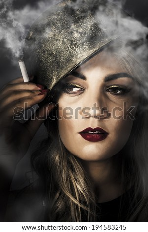 Artistic portrait on the face of an attractive blonde pin up woman holding lit smoke wearing soldier helmet. 1940 military pinups - stock photo