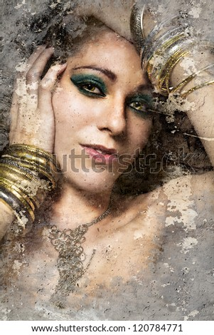 Artistic portrait with textured background, beautiful woman with gold and silver jewelry