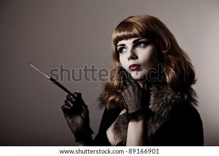 Artistic shot of attractive retro-woman, with film grain - stock photo