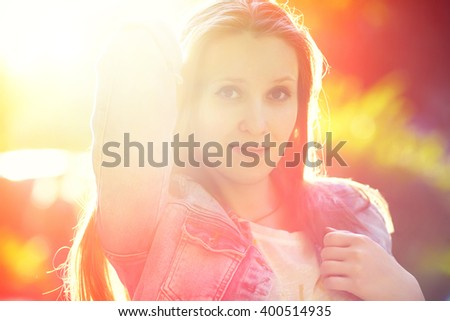 artistic soft focus portrait of a stylish brunette woman in a summer park