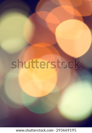 Artistic style - Defocused urban abstract texture bokeh city lights in the background with blurring lights for your design, vintage or retro color toned - stock photo