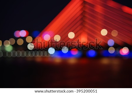 Artistic style - Defocused urban abstract texture bokeh city lights in the background with blurring lights for your design, vintage or retro color toned