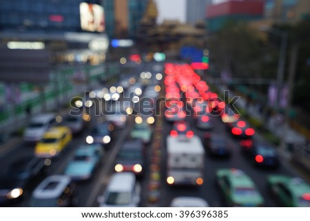 Artistic style - Defocused urban abstract texture bokeh city lights & traffic jams in the background with blurring lights.