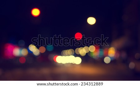 Artistic style - Defocused urban abstract texture ,bokeh of city lights in the background with blurring lights for your design, vintage or retro color tone - stock photo
