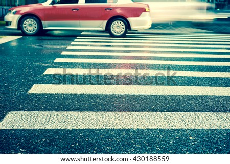 Artistic style - Vintage style,Crosswalk and pedestrian at modern city zebra crossing street in rainy day. Blur abstract.Background concept. - stock photo