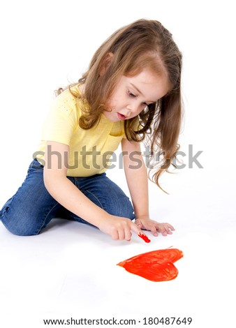artistic sweet little girl painting with hands a heart in red color paint  - stock photo