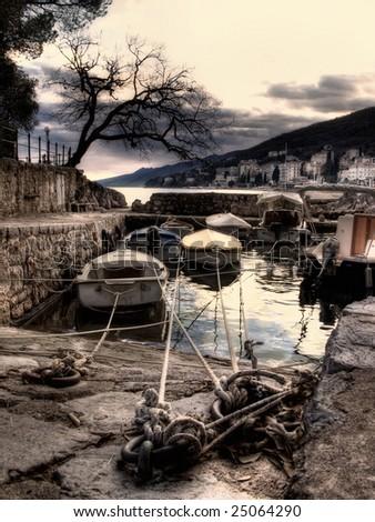 Artistic view on boat in small harbor, in Opatija,Croatia - stock photo