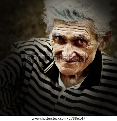 Artistic vintage portrait of senior man - stock photo