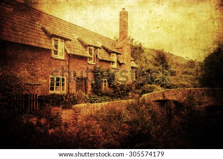 artistic vintage style picture with an old cottage and a historic packhorse bridge in Allerford, Somerset, England - stock photo