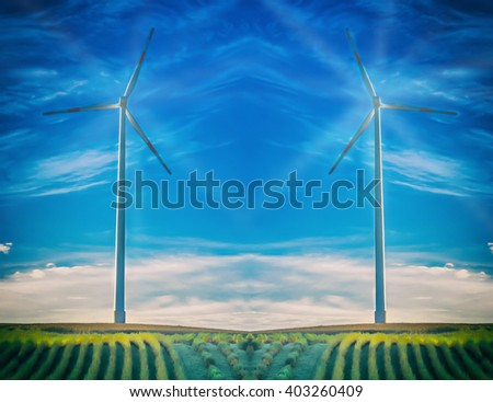 Artistic work of my own. HDR processing. Intentional blur. Wind turbine with light rays at abstract blue sky. - stock photo