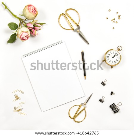 Artistic workplace flat lay. Paper, sketchbook, flowers, office tools and accessories. Flat lay, top view - stock photo