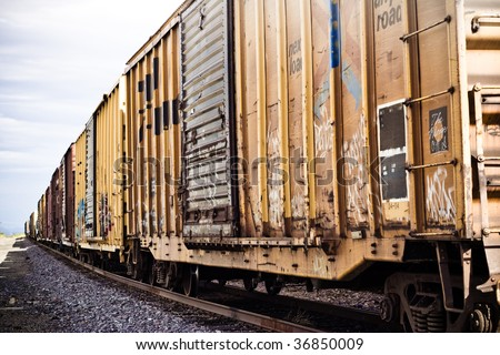 Artistic yellow and brown train cars and tracks