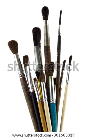 Artists old brushes isolated on white. Vertical image.