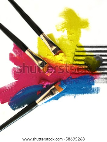 Artists paint brushes coloring a heart in CMYK color - stock photo