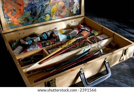 Artists Paint kit with easel and brushes - stock photo