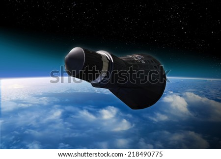 Artists recreation of a Gemini space capsule orbiting earth circa early 1960's. - stock photo