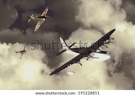 Artists recreation of a World War 2 fight between fighters and a flying boat. - stock photo