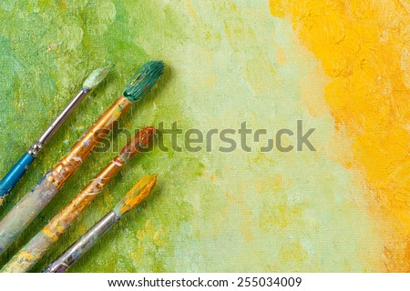 Artists vintage tools brushes on artistic background  - stock photo