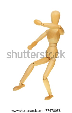 Artists wooden manikin in a martial arts fighting pose isolated against white