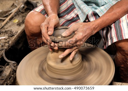 Arts and crafts working clay bowls.