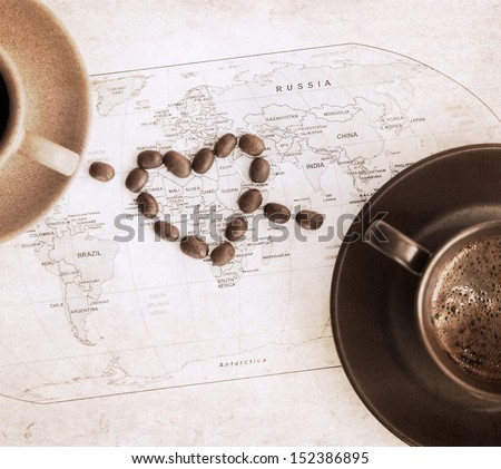 artwork  in grunge style,  heart symbol, wold political map and two cups of coffee - stock photo
